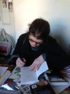 CAROLEL SIGNING 1ST BOOK